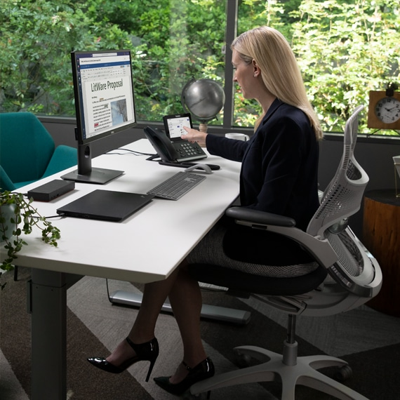 Photograph of an executive at their desk joining a Microsoft Teams meeting via desk phone.