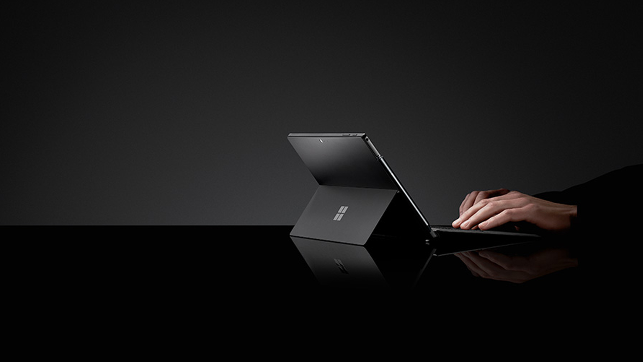 A person types on Surface Pro 6 and Surface Pro Type Cover, both in Black