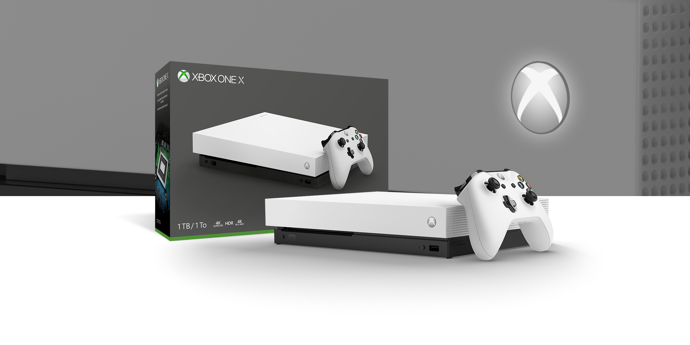 Xbox One X Robot White Special Edition console in front of a hardware bundle box.
