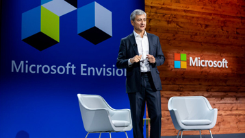 Jean-Philippe Courtois standing on the main stage at Microsoft Envision