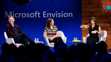 Christina Hall, Chuck Edward and Francesca Gino in discussion and seated on the main stage of Microsoft Envision