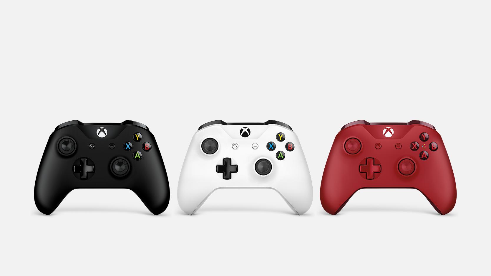 Manettes Xbox noire, blanche et rouge
