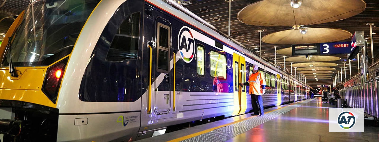 lightrail cars inside a terminal with Auckland Transport logo overlay