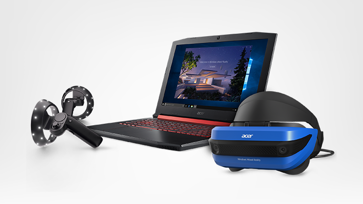 An Acer Laptop, VR headset, and motion controllers