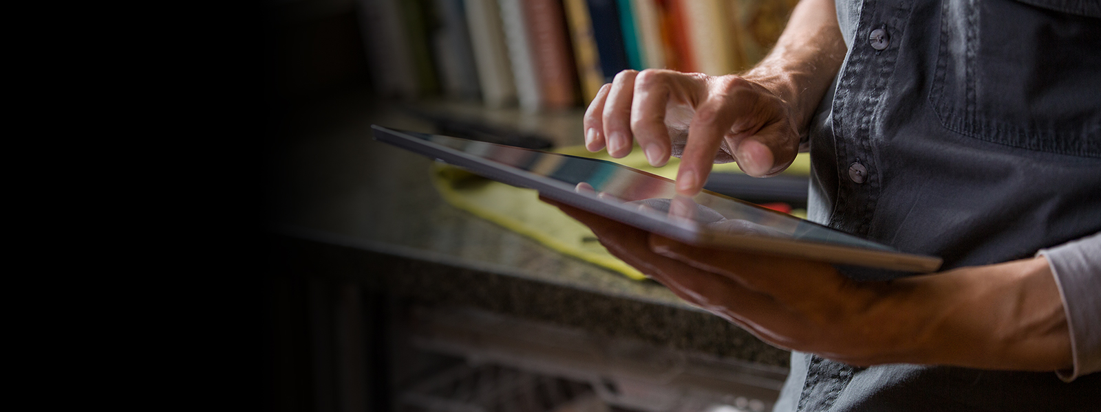 A man holding a tablet.
