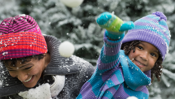 Two people playing in the snow