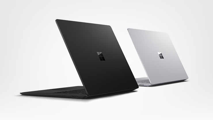 2 Surface Laptop, one black and one platinum
