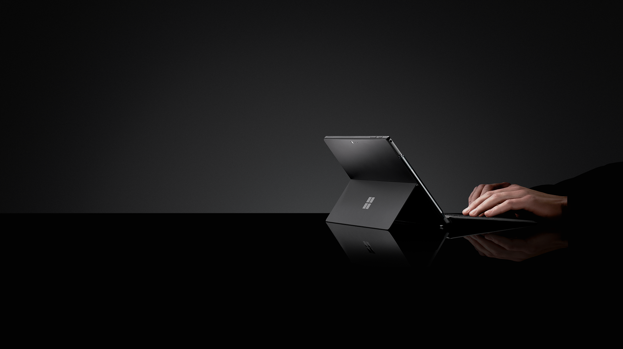 Hands type on a Surface Pro 6 with Type Cover