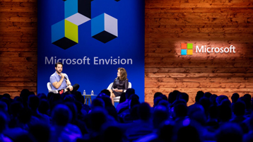 Alexis Ohanian and Peggy Johnson in discussion on stage at Microsoft Envision