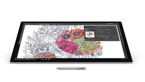 Adobe Illustrator CC が画面に表示された Surface Studio と Surface ペン。