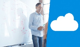 Photograph of a person standing in front of a large whiteboard and a simple illustration of a cloud