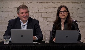 Still image from video with Bret Arsenault, CISO at Microsoft, seated at a table next to a moderator