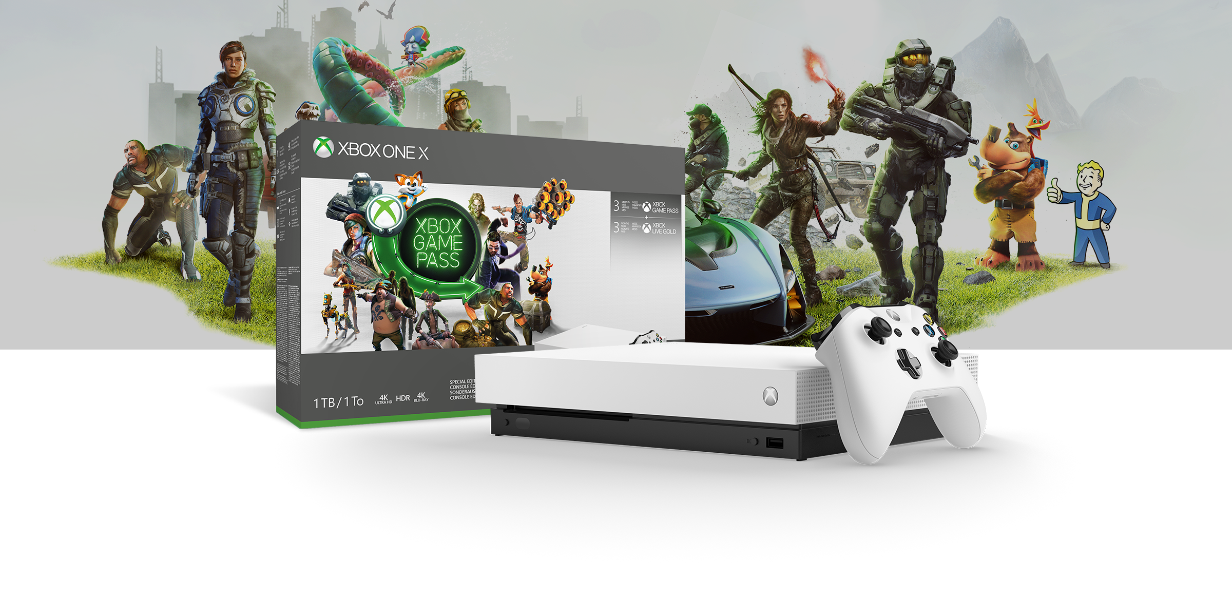 Xbox One X Robot White Special Edition console in front of a hardware bundle box featuring gamepass art