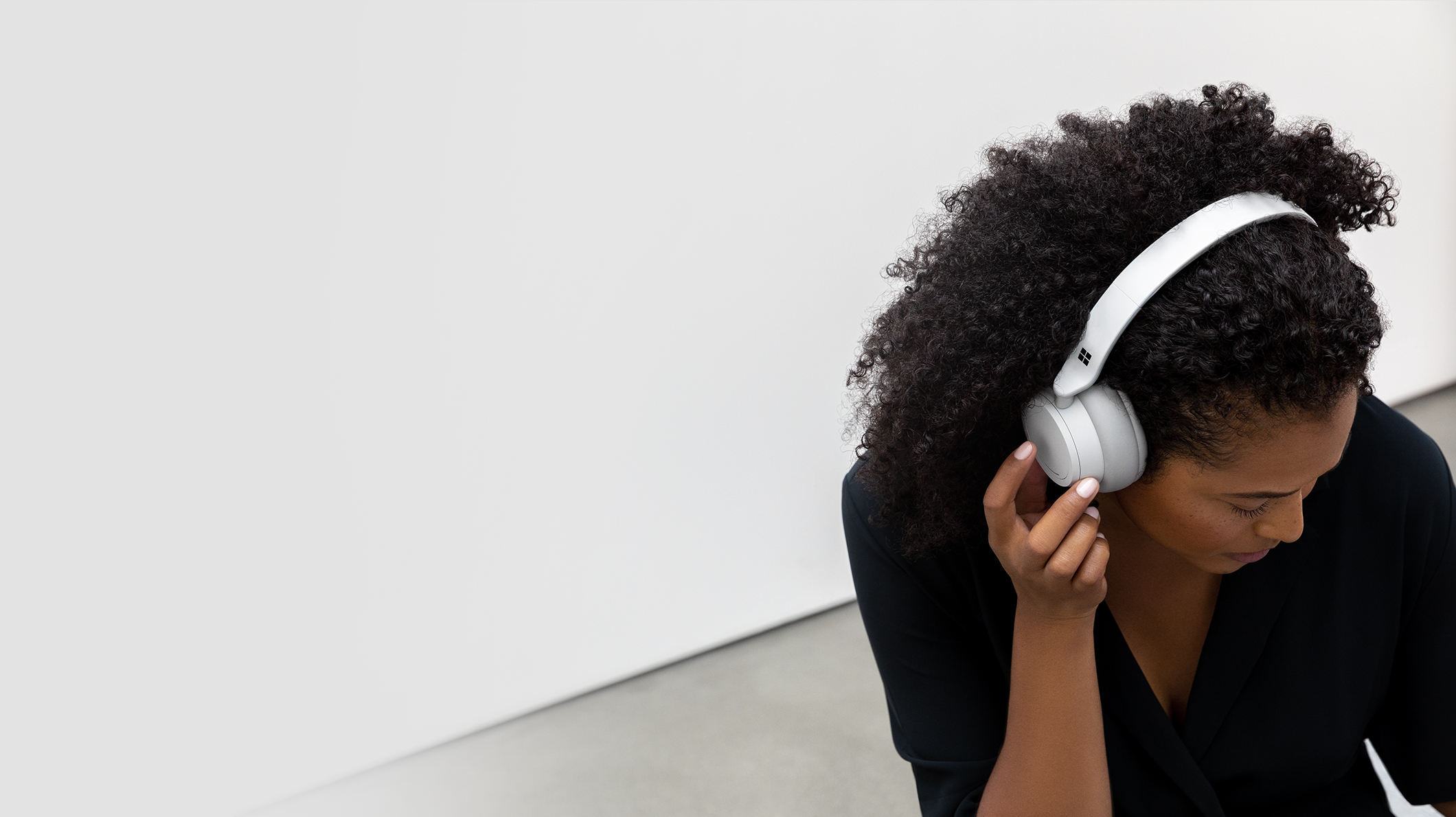 A woman using Surface Headphones