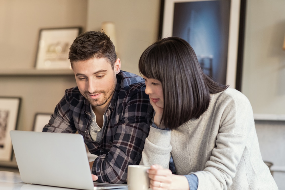 Man using Office 365 on laptop at home