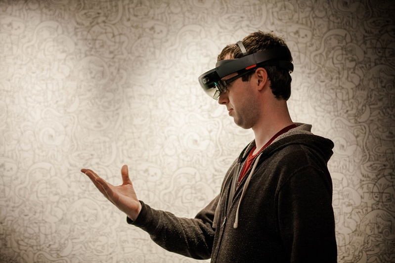 Philip Jarvis wearing a HoloLens making a gesture