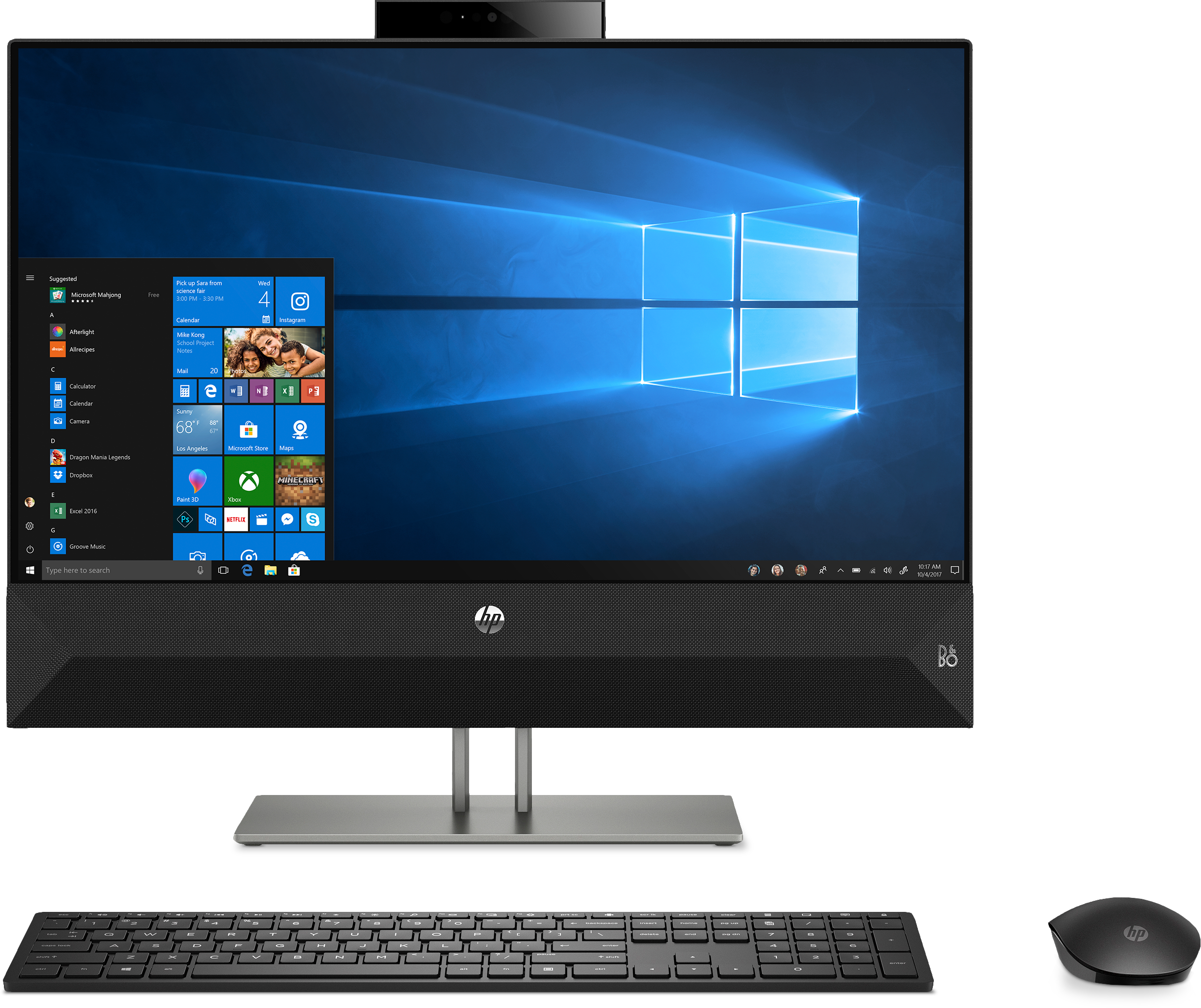 HP Pavilion 24-XA0031 AIO from the front with keyboard and mouse. Windows is on screen.