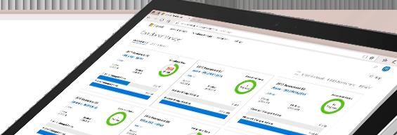 Foto eines Gerätebildschirms, auf dem die Compliance-Manager-Oberfläche mit Grafiken und Informationen dargestellt ist