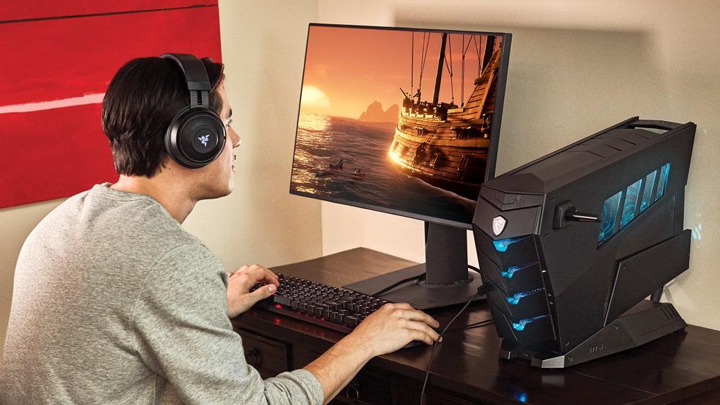 Człowiek grający w grę na komputerze stacjonarnym z Windows 10.