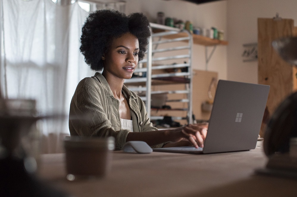 Entrepreneur using Surface Laptop 2 (Platinum) in art studio
