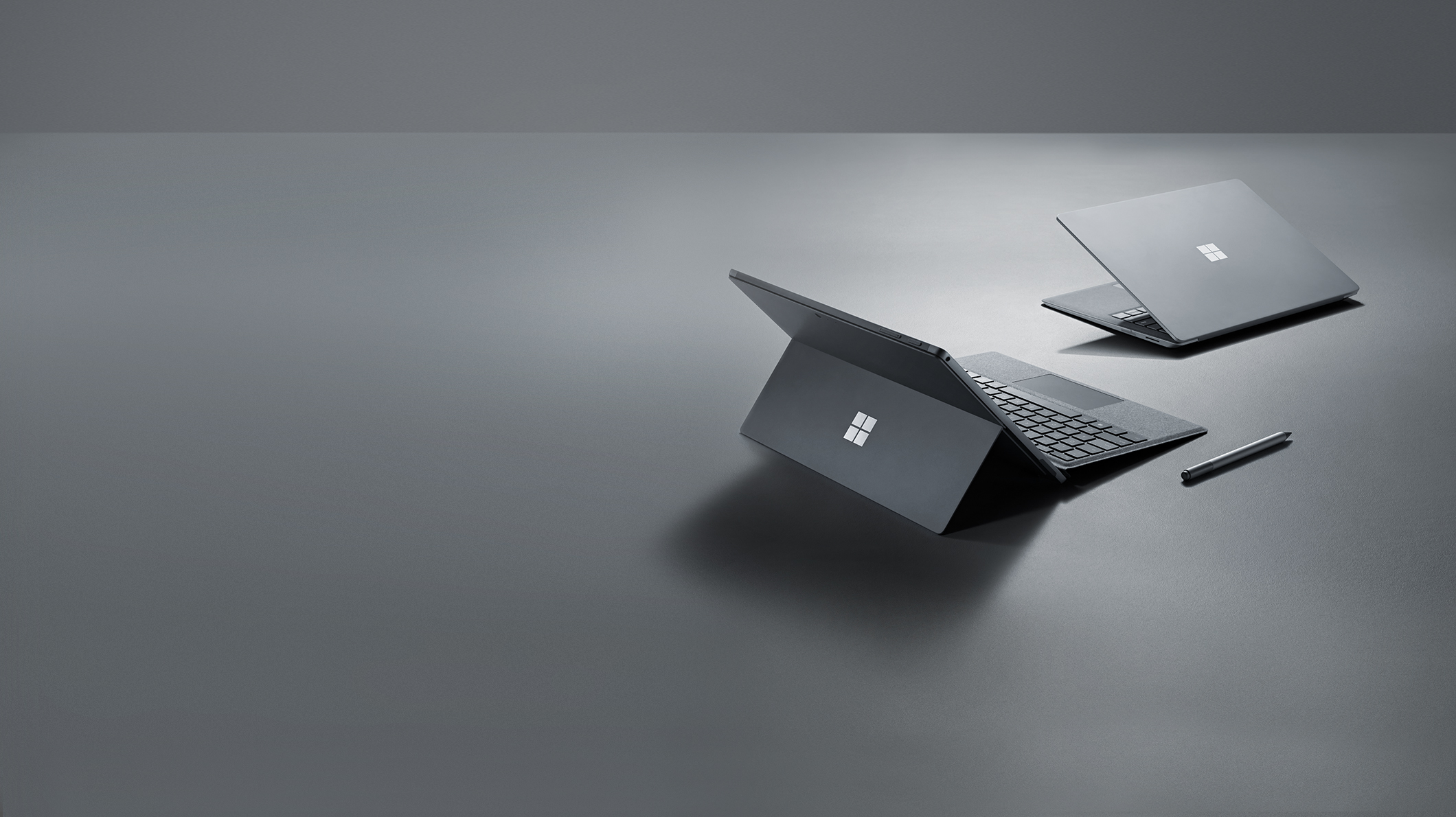 A Surface Laptop 2 and a Surface Pro 6 on a desk