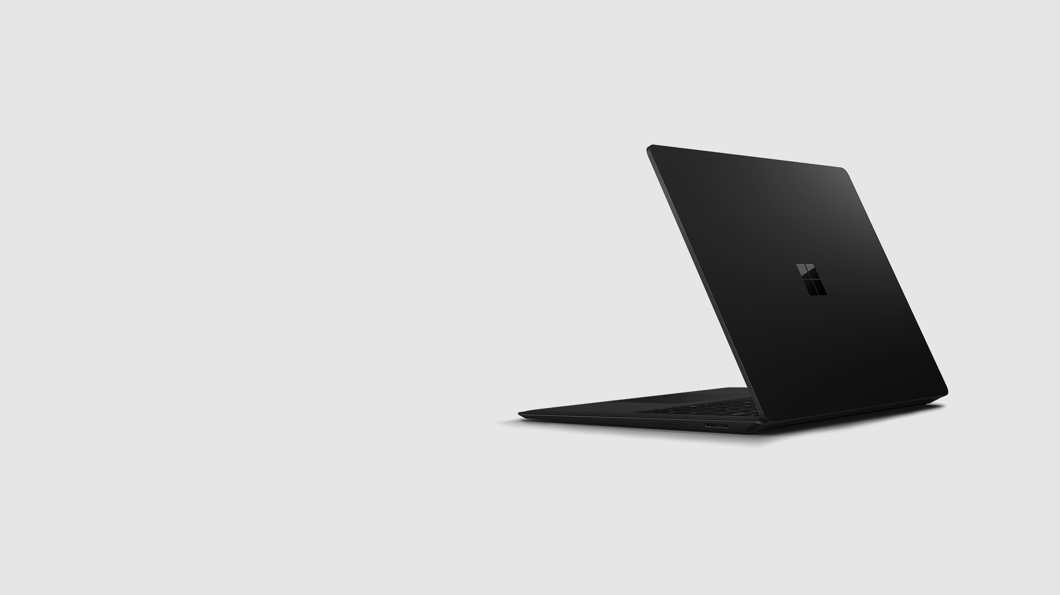 The back side of the black Surface Laptop 2