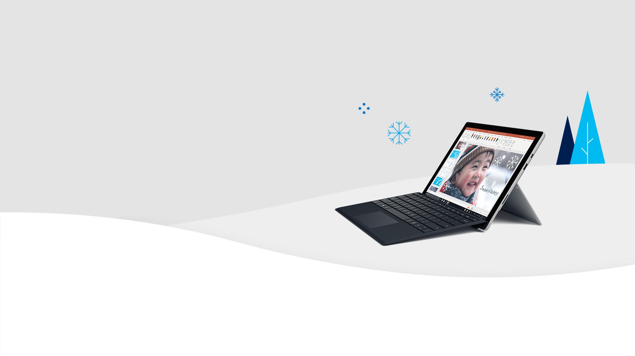 Surface Pro con neve e alberi di Natale