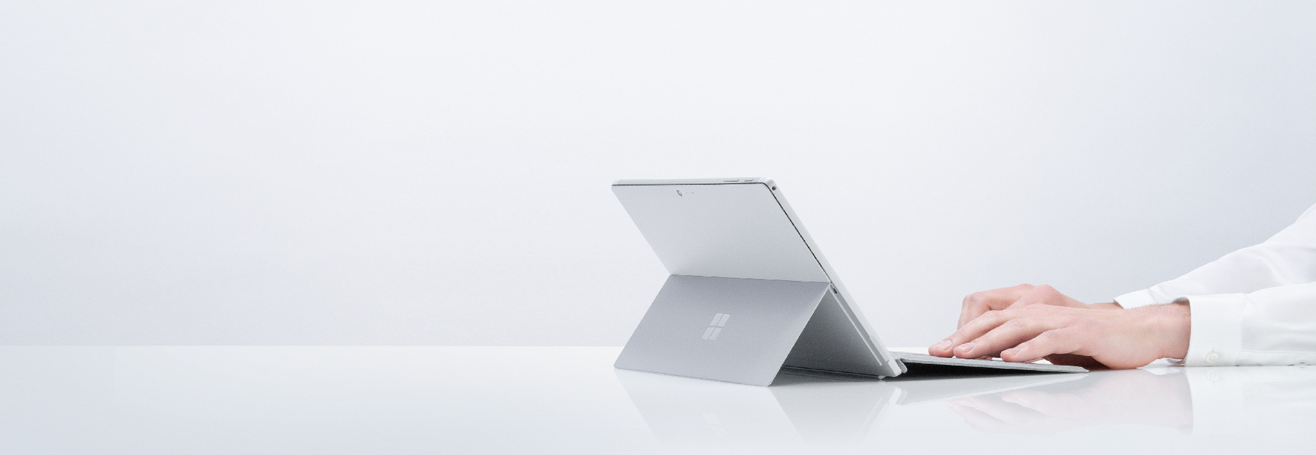 A Surface user's hands on their Surface Pro device