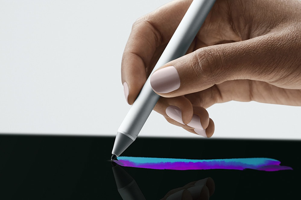 Surface Pen interacting with the screen of Surface Studio 2