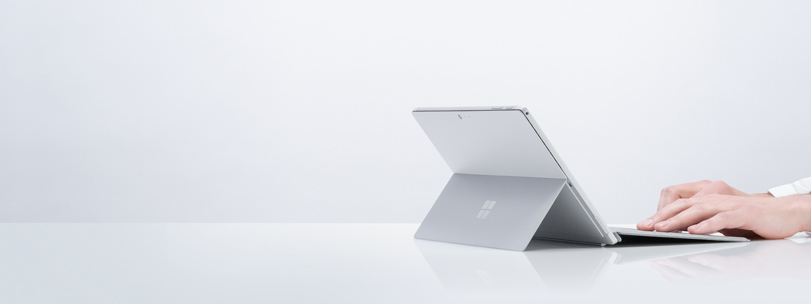 Someone types on a Surface Pro 6 with Type Cover
