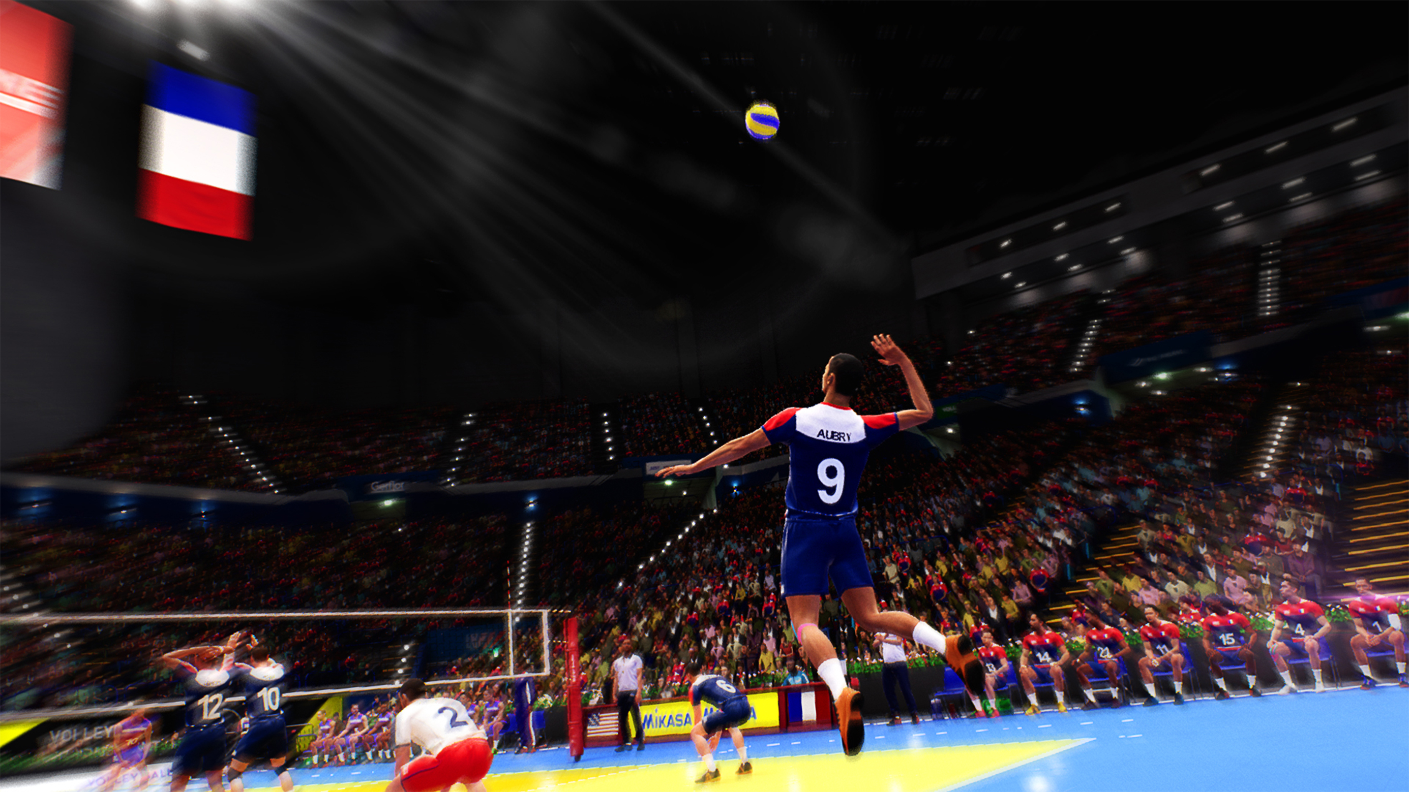 Volleyball player jumping up to spike the volleyball