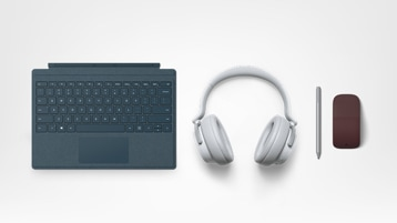 A cobalt Surface Type Cover, Surface headphones, Surface Pen, and a Surface Arc Mouse