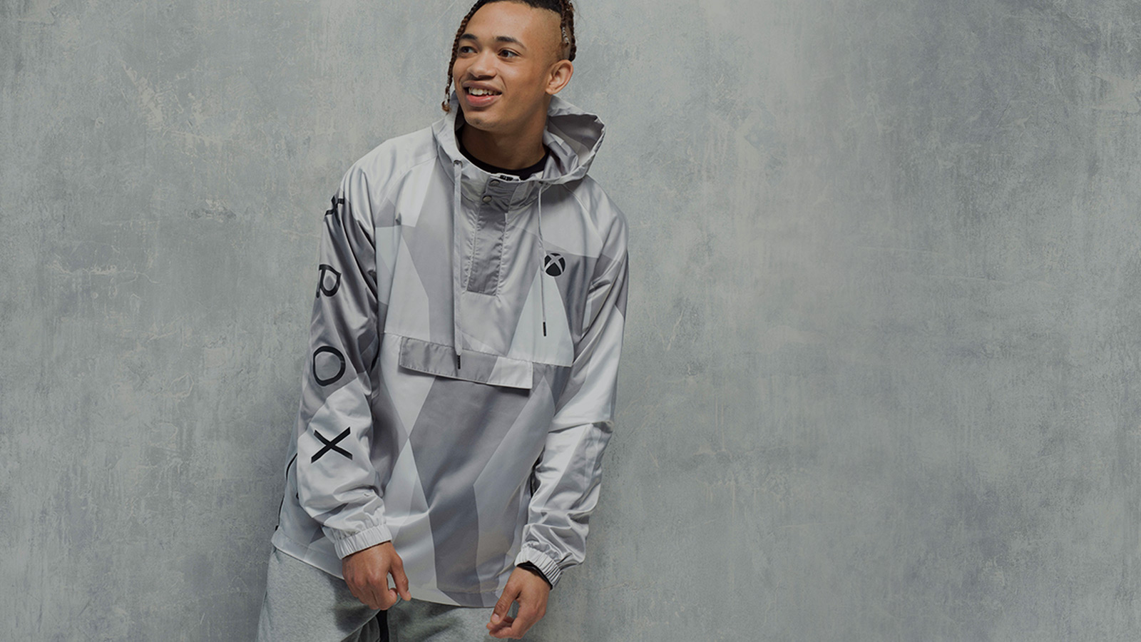 Man wearing an xbox sweat shirt in front of a grey background