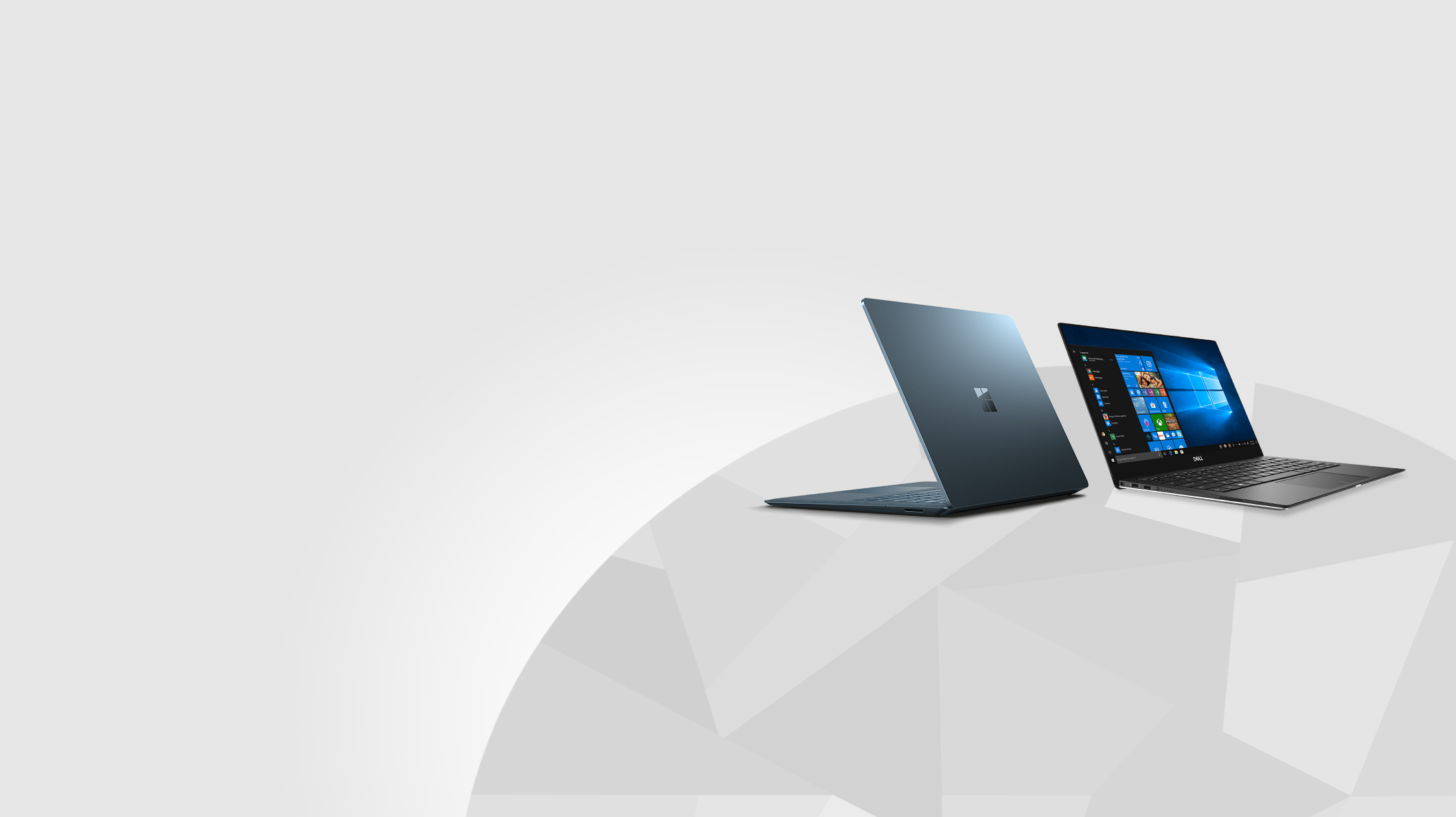 A Cobalt Surface Laptop 2 and a Dell XPS 13 sit on an illustration of the Earth
