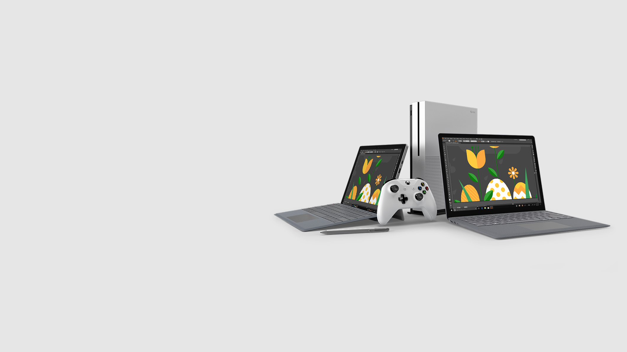 A Surface Pro 6 with Surface Pen, an Xbox controller, an Xbox One S and a Surface Laptop 2