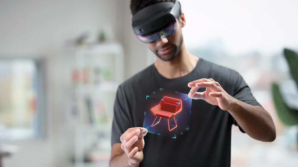 Developer wearing HoloLens 2 headset modifying hologram
