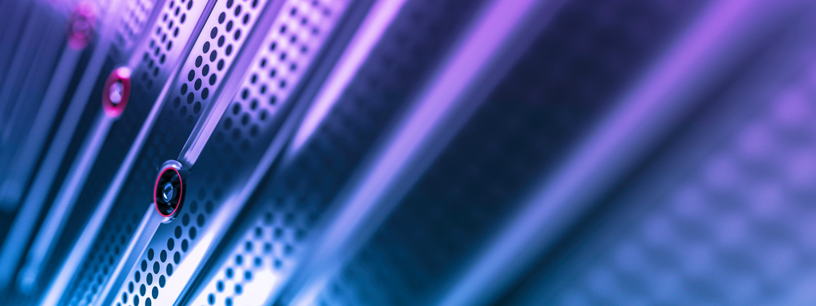 Close view of a server illuminated in blue and purple hues