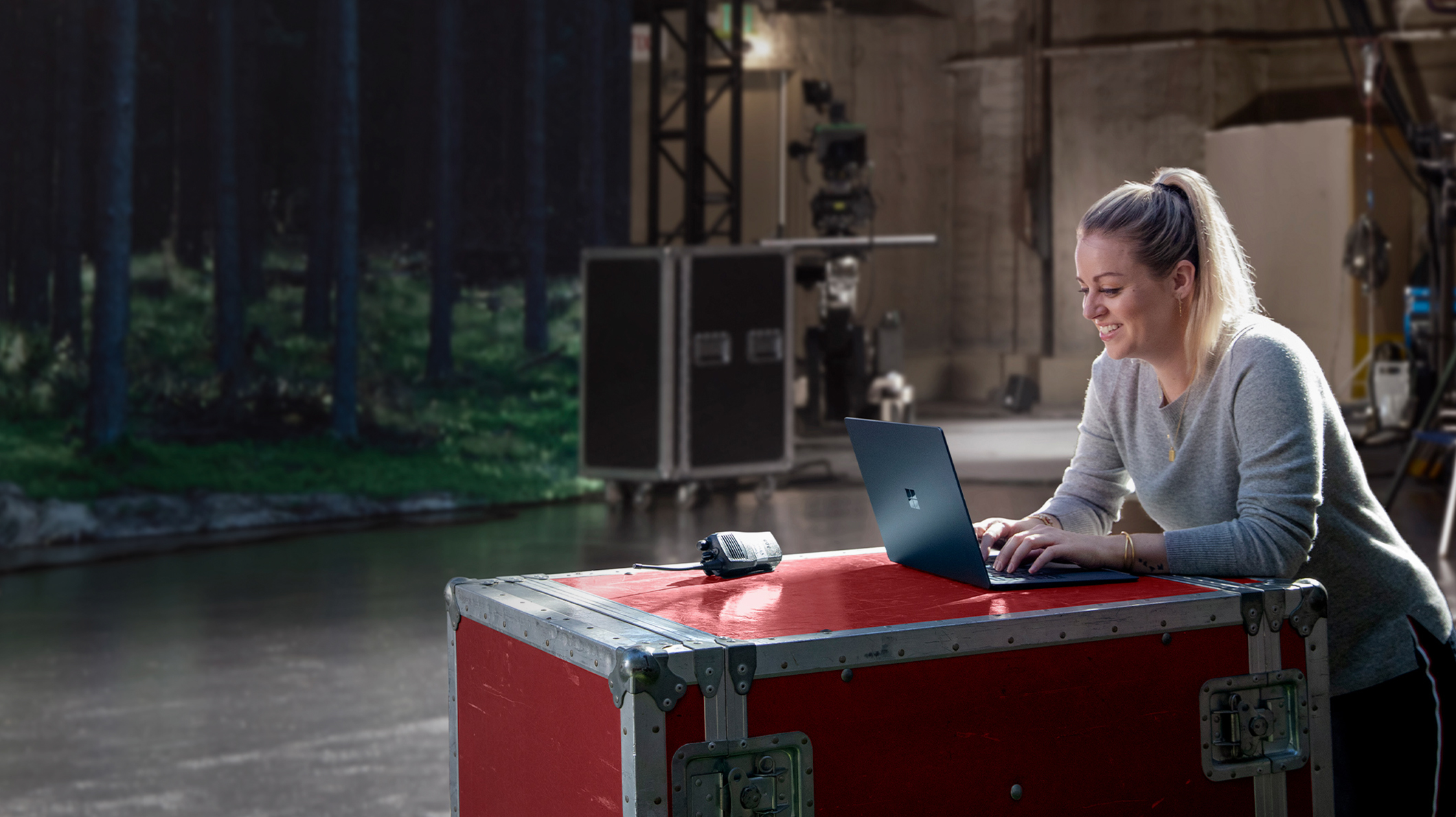 TV and Podcast producer Taylor Church using her Surface Laptop on set