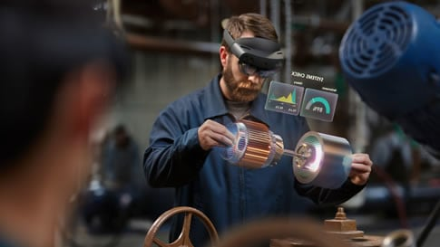 Workers looking at a jet engine in a virtual environment