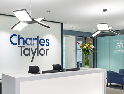 Photograph of Charles Taylor front desk and lobby