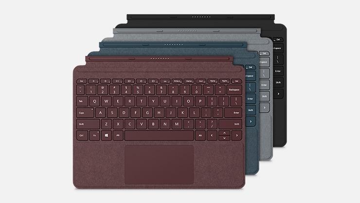 A Burgundy, Cobalt Blue, Platinum, and Black Surface Go Signature Type Cover