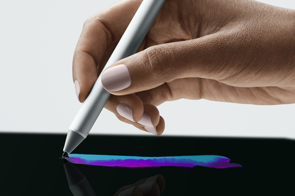 A person using a Surface Pen to draw on their Surface Go