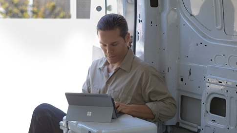 Person works on a Surface Go