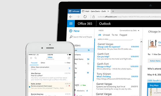 Outlook inbox displayed on a device and a phone