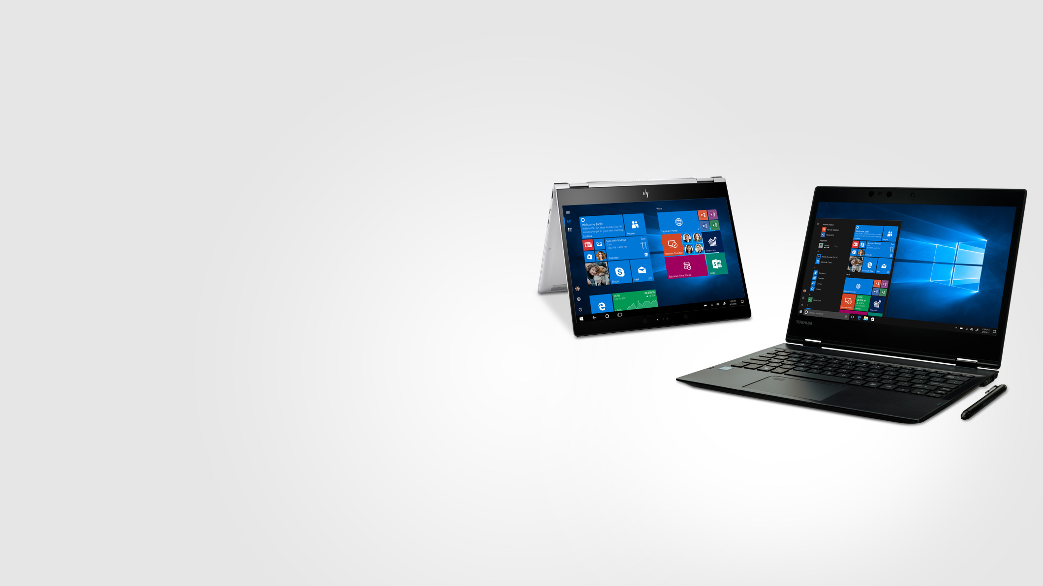 Two Windows 10 Pro laptops displaying Windows 10