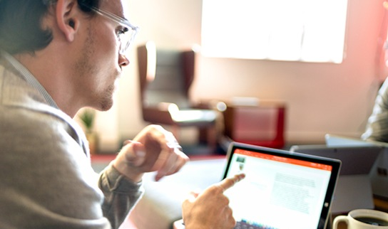 A person in an office using a device