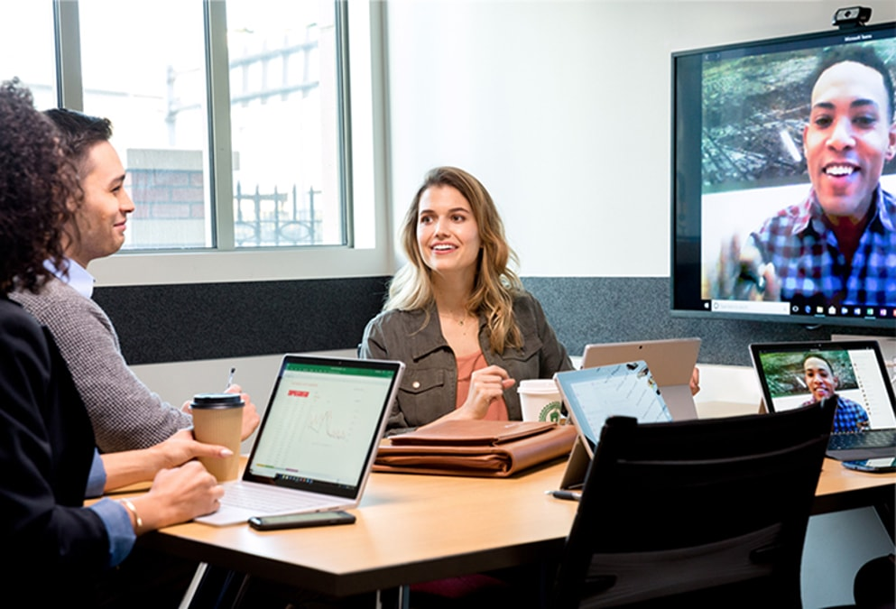 A group of co-workers video conferencing during a meeting