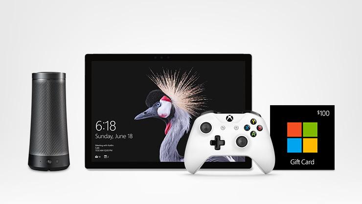 Surface Pro, white Xbox One controller, Microsoft Store gift card, and Harman Kardon Invoke with Cortana