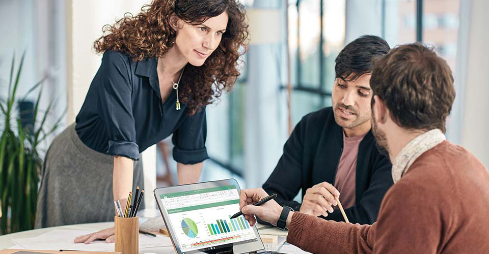 Pictures office Grey Three People Working In An Office Collaborating On Laptop Computer With Office 365 Officefurniturecom Office 365 For Business Microsoft Cloud Services