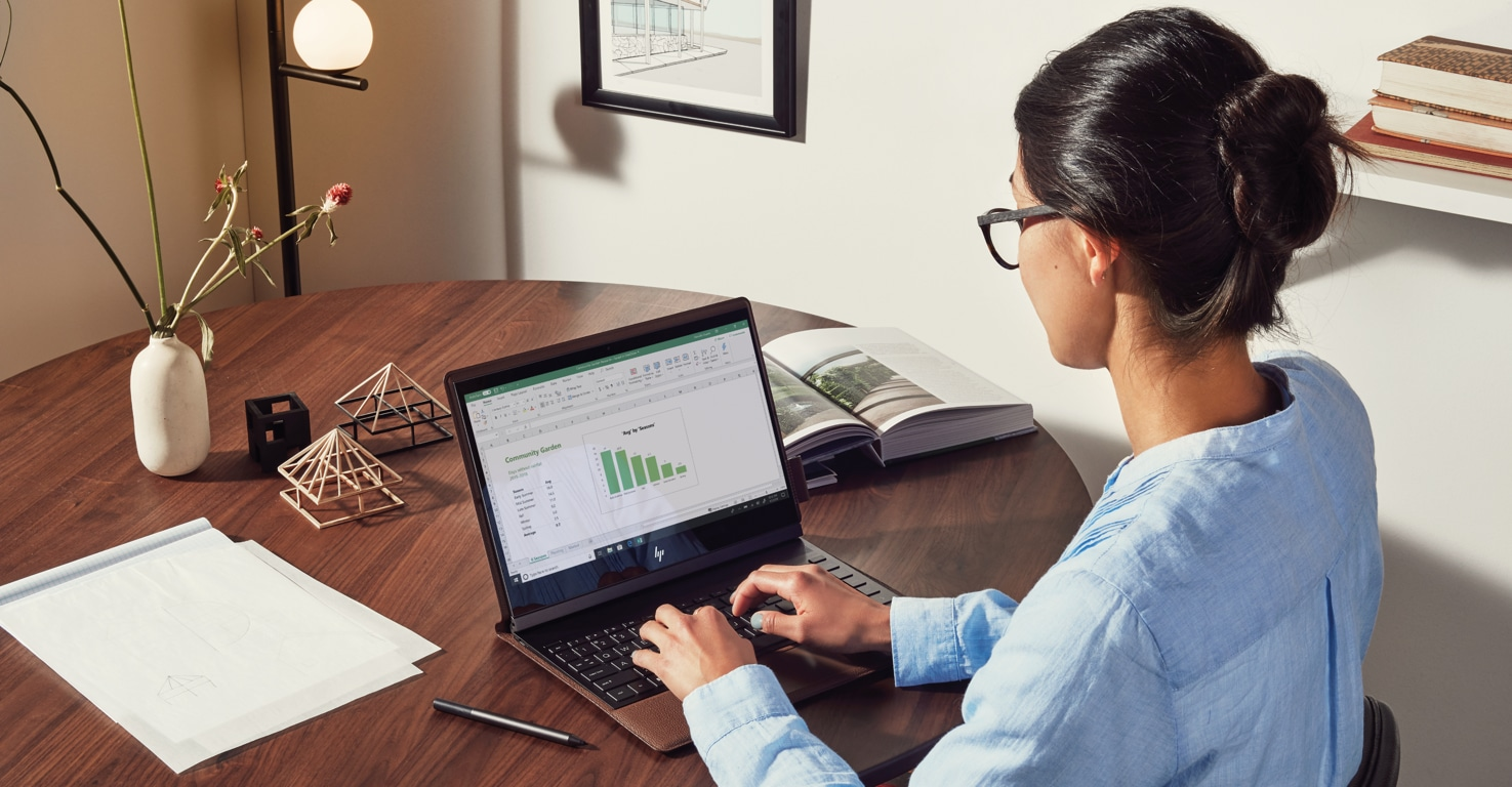A laptop featuring an Excel expense report, next to a cup of coffee and some tools
